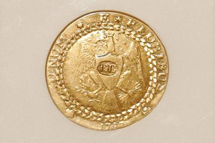 Первую золотую монету США продали на аукционе